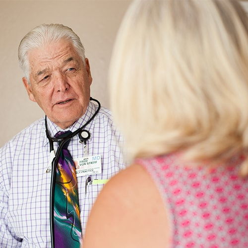 Dr. Von Stieff speaking with a patient about California Occupational Medicine