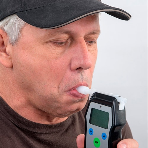 Man doing alcohol test at Occupational Medicine in California